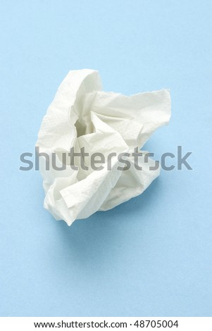 Crumpled two ply tissue paper on blue seamless background - stock photo