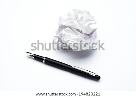 crumpled up paper wads and Fountain pen,  isolated on white background. Writing concept - stock photo