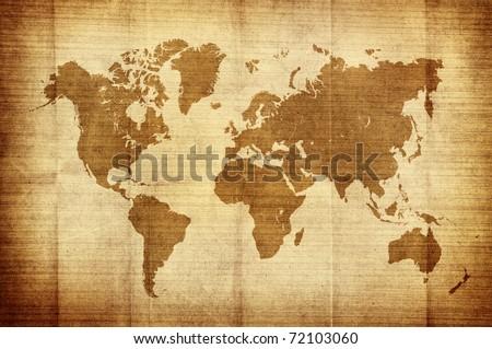 crumpled vintage world map - stock photo
