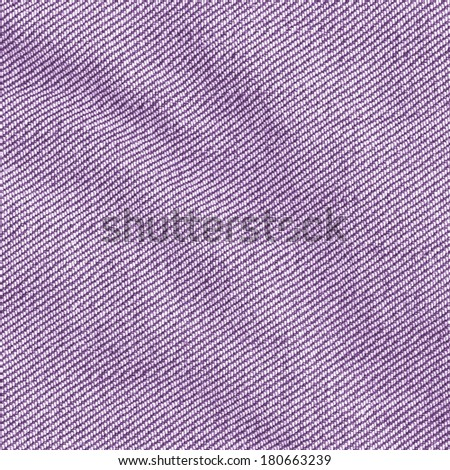 crumpled violet jeans fabric closeup - stock photo
