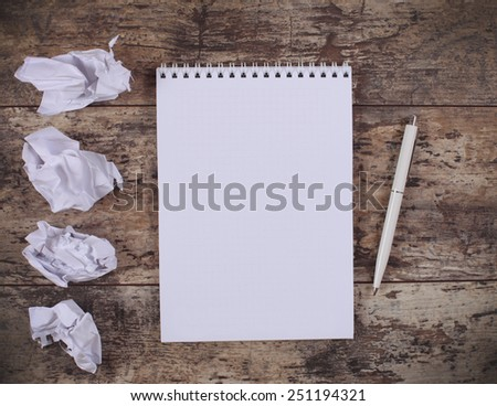 crumpled wads, notebook on the wooden desk  - stock photo