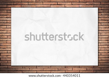 Crumpled white paper on old brick wall dark edged with copy space for text or image. Blank paper texture. paper background for design. - stock photo