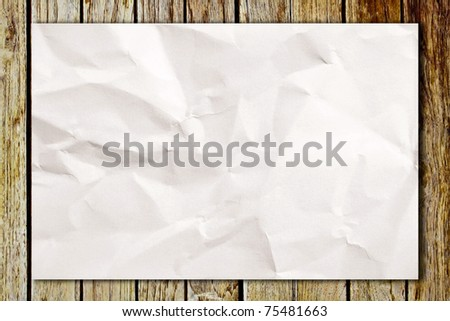 Crumpled white paper on wooden table