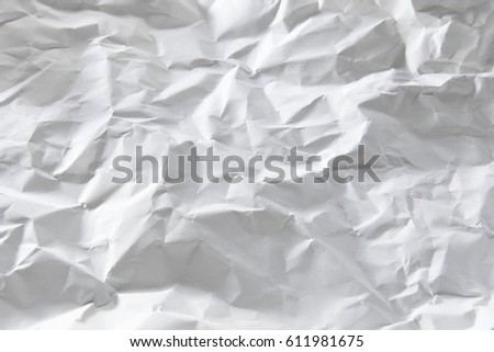 Crumpled white paper texture with copy space for text or image , piece of Crumpled note paper , Office table with crumpled paper sheet , top view