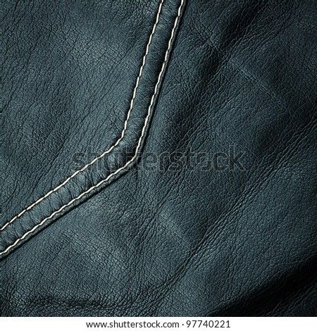 Crumpled worn leather texture with a seam
