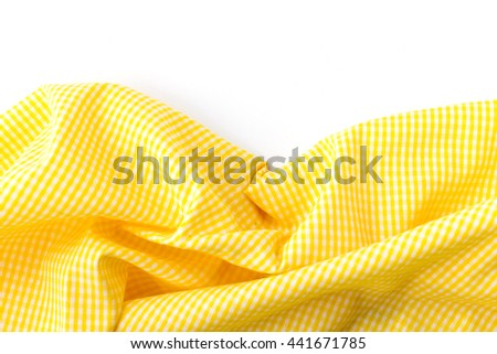 Crumpled Yellow Tablecloth On White Background