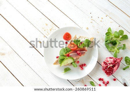 Crunchy bread with lettuce and smoked bacon - stock photo