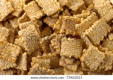 Crunchy breakfast cereals background with all sorts of nuts, food texture.