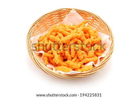 Crunchy cheese snacks in the basket isolated on white background - stock photo