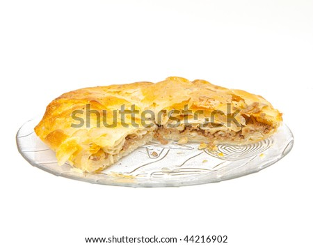 crunchy freshly baked layered meat pie - stock photo