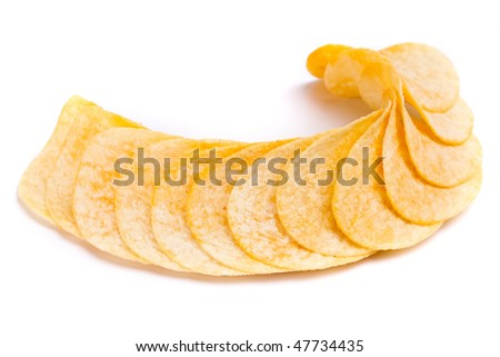 crunchy potato chips isolated on white background. Isolated pile of unhealth snack - salty potato chips.