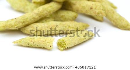 crunchy snack of fried green pea pods isolated on white