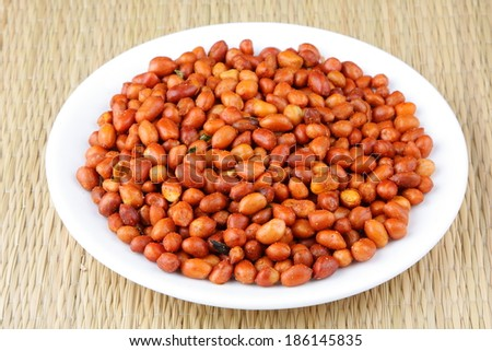 Crunchy Spicy Peanuts served in plate. - stock photo