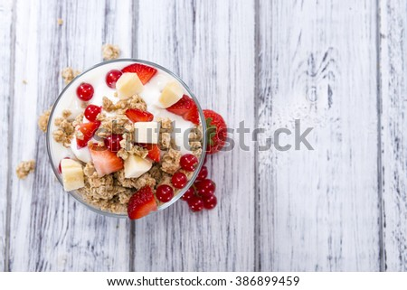 Crunchy Yoghurt with some fresh fruits (detailed close-up shot) - stock photo