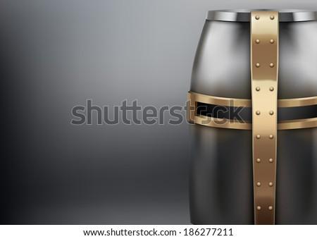 Crusader Metallic Knight's Helmet with a golden cross. - stock photo