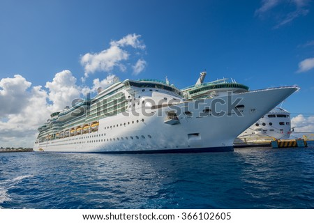 Cruse ship ocean sea luxury travel vacation massive modern boat caribbean cozumel mexico dock port - stock photo