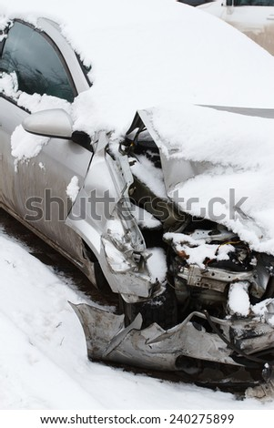 Crushed car in winter - stock photo