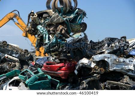 Crushed cars in a junkyard - stock photo