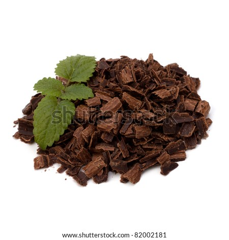 Crushed chocolate shavings pile and mint leaf isolated on white background - stock photo