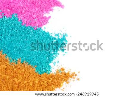 Crushed colored eyeshadow on a white background - stock photo