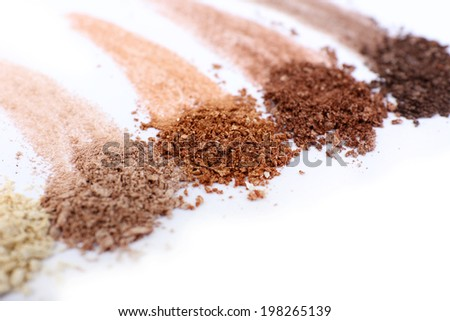 Crushed eyeshadow isolated on white - stock photo