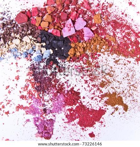 crushed eyeshadow on white background - stock photo