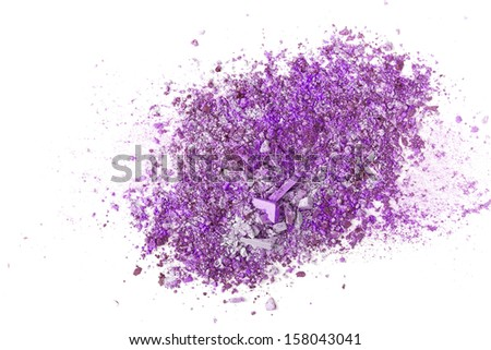Crushed eyeshadows on white background. Beauty concept
