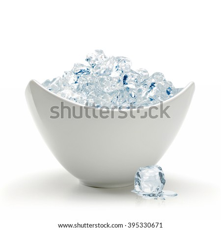 Crushed ice in bowl on white background - stock photo