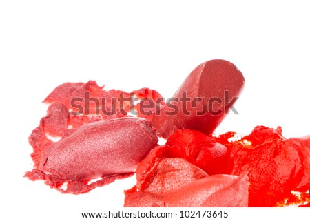 crushed lipsticks isolated on white background