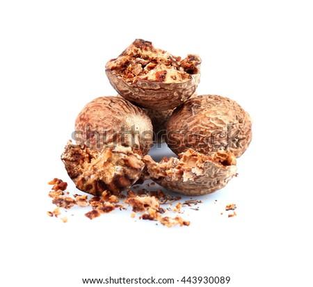 Crushed nutmeg isolated on white - stock photo