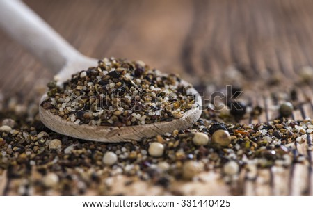 Crushed Peppercorns with different spices and salt (close-up shot) - stock photo