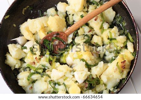 Crushed potatoes with spring onion and garlic - stock photo