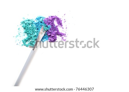 Crushed powder pigments, on white background with copy space.