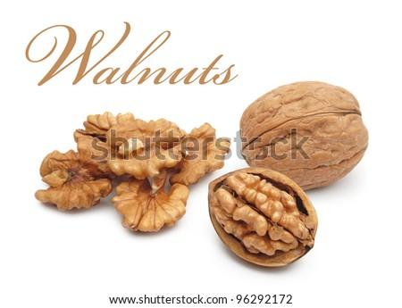 Crushed walnuts on white background - stock photo