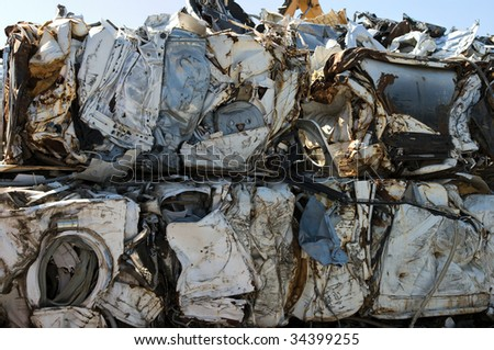 Crushed washing machines for metal recycling - stock photo