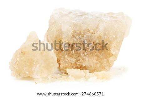 Crust of sea salt from Dead Sea coast isolated on white - stock photo