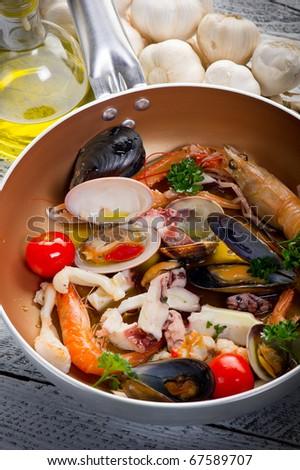crustacean over casserole - stock photo