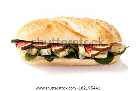 Crusty freshly baked golden French baguette with figs , spinach and blue cheese on a white background