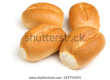 Crusty white bread rolls on white background - stock photo