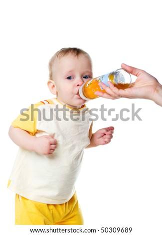 Cry baby drink fruit juice. Studio shot - stock photo