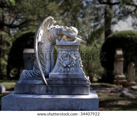 Crying angel statue in Glenwood Cemetery in Houston, TX - stock photo