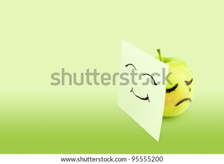 Crying apple on green background. Concept - stock photo