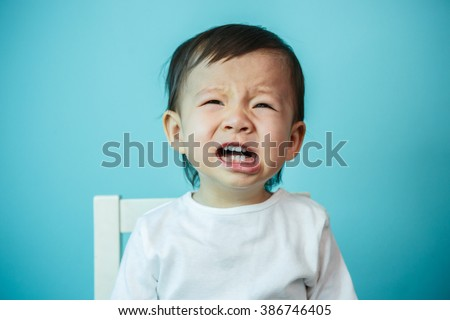 Crying Asian child portrait (soft focus on the eyes) - stock photo