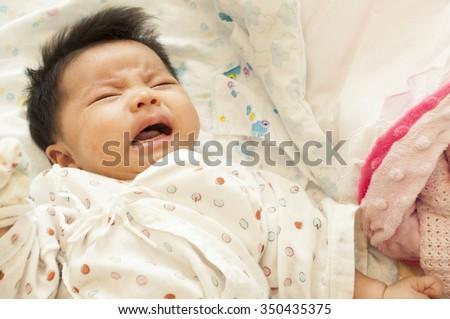 Crying asian newborn baby  - stock photo
