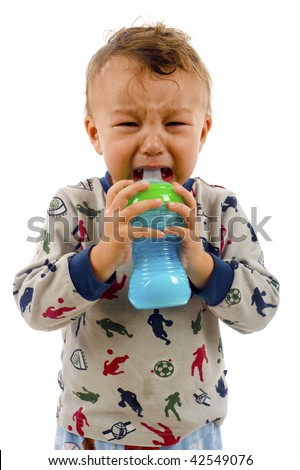 Crying baby boy holding a bottle isolated over a white background - stock photo