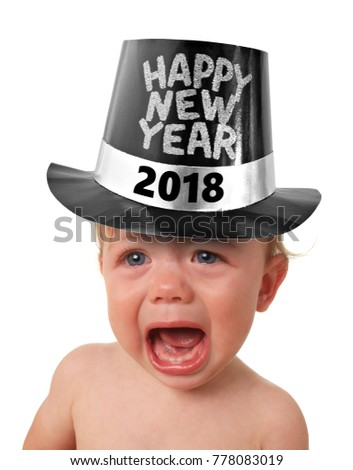 Crying baby boy wearing a Happy New Years 2018 hat, studio isolated on white.