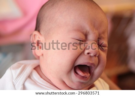 Crying baby close-up - stock photo