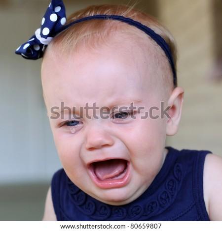 crying baby girl - stock photo