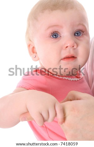 crying baby holding fathers finger - stock photo