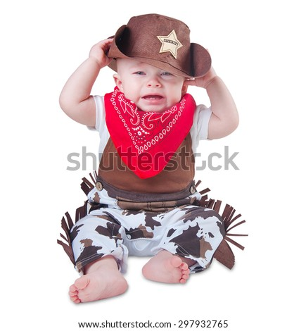 Crying baby in cowboy outfit - stock photo